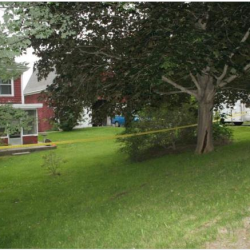 Police tape surrounds a house on Montgomery Road in Boothbay Harbor, where state and local police are investigating a death.  Courtesy Boothbay Register