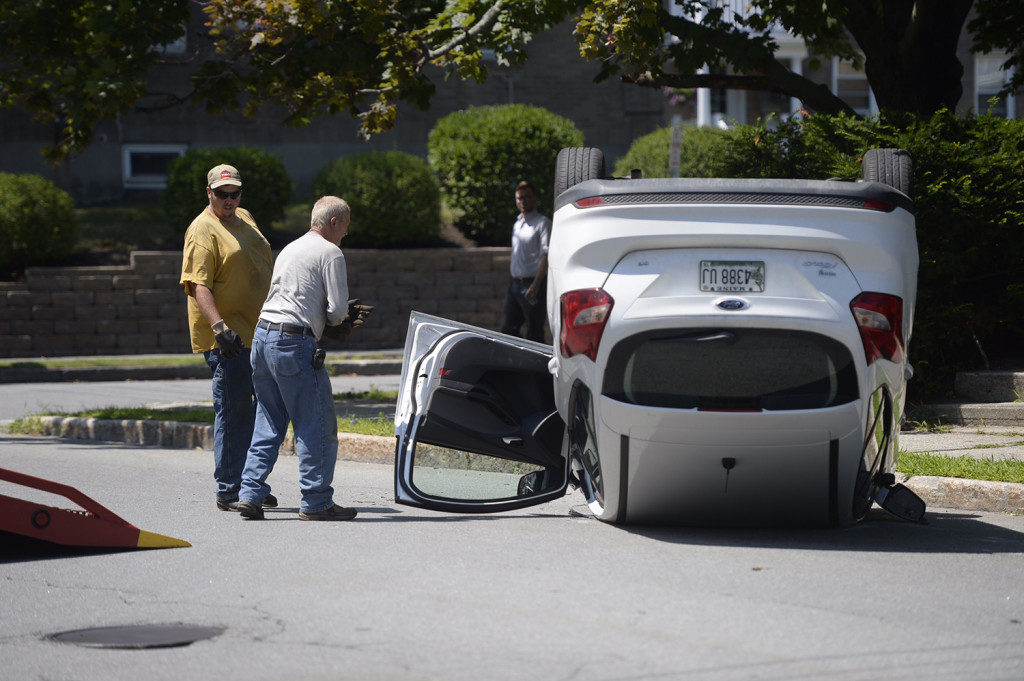 A man driving a Ford sedan clipped the pole as he tried to take a left turn from Beacon Street onto Woodford Street. Shawn Quellette/Staff Photographer