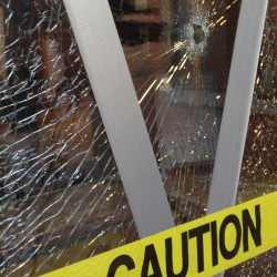 Gunshots Friday morning shattered door windows at the Monument Square entrance of One City Center. Photo by Gillian Graham / Staff Writer