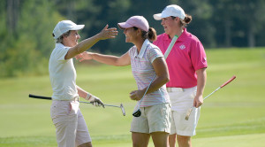 SACO, ME - JULY 29: Staci Creech, center is congratulated by Laurie Hyndman, left and Emily Bouchard, right after Creech won the Maine Woman's Amateur golf tournament at the Biddeford Saco Country Club in Saco Wednesday, July 29, 2015. (Photo by Shawn Patrick Ouellette/Staff Photographer)