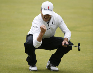 Zach Johnson of the U.S. reacts after making his birdie putt on the 18th green during the final round of the British Open on the Old Course in St. Andrews, Scotland.