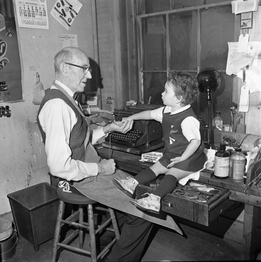 B. Frank Packard, typewriter repairman, with Elizabeth Silverman (daughter of Sally Silverman Wigon). The photo taken at Joe Wigon Office Supply, 28 Free Street, Nov. 11, 1965. From the Portland Public Library archival collection of Portland Press Herald, Maine Sunday Telegram and Evening Express photos.