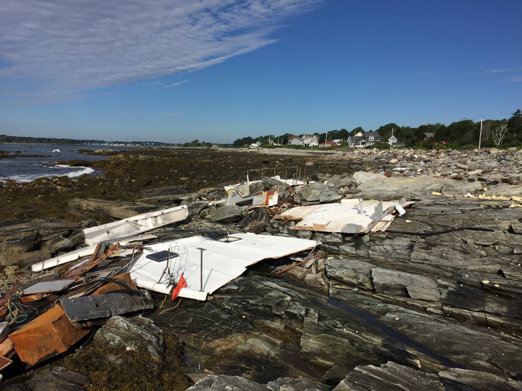 The remains of a drifting boat litter the rocky shore of Peaks Island Wednesday. Photo courtesy of Jim Memmott