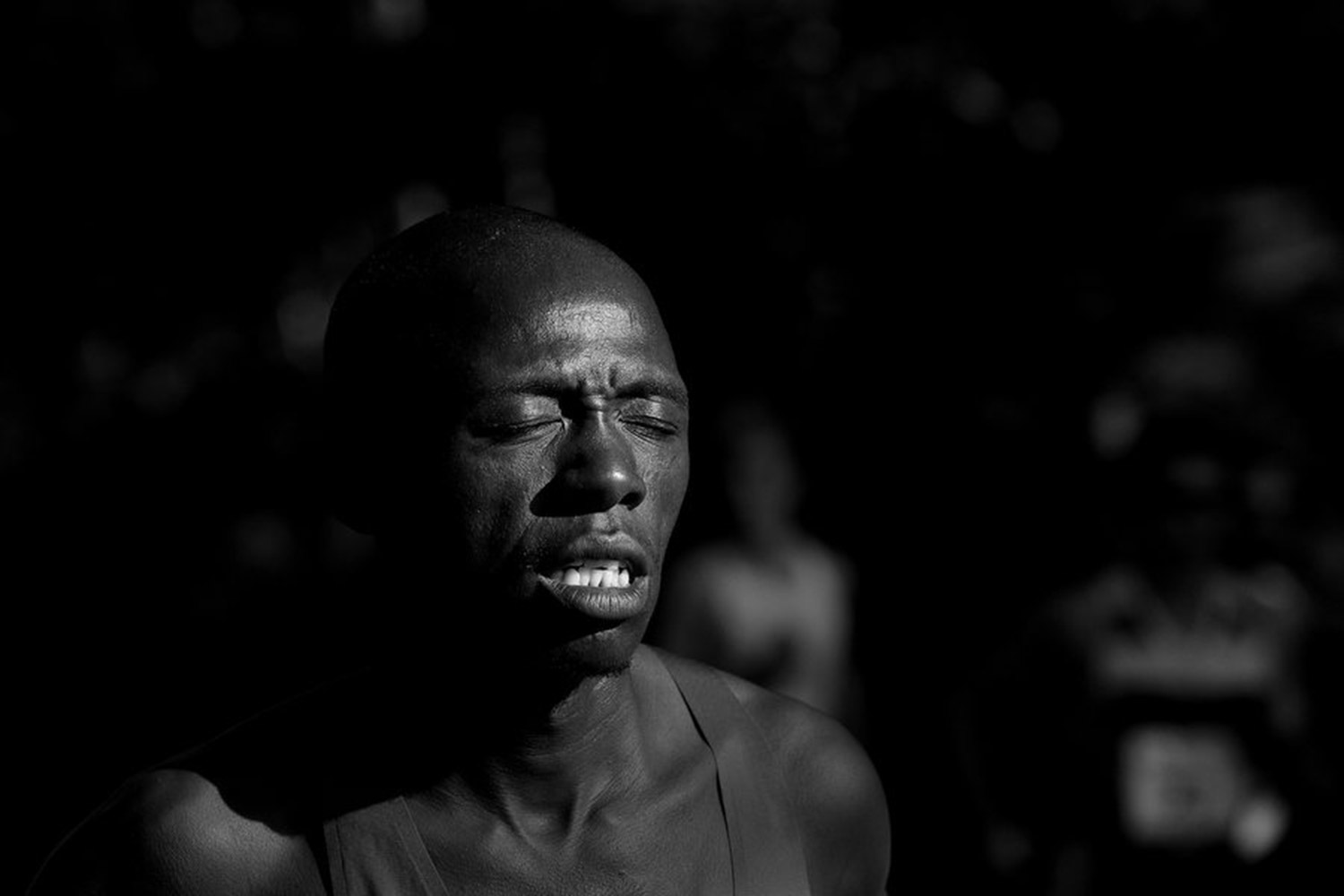 Daniel Salel of Kenya makes his way along the course in hot conditions during the TD Beach to Beacon 10K. The story of the race can be told through the faces of the runners.