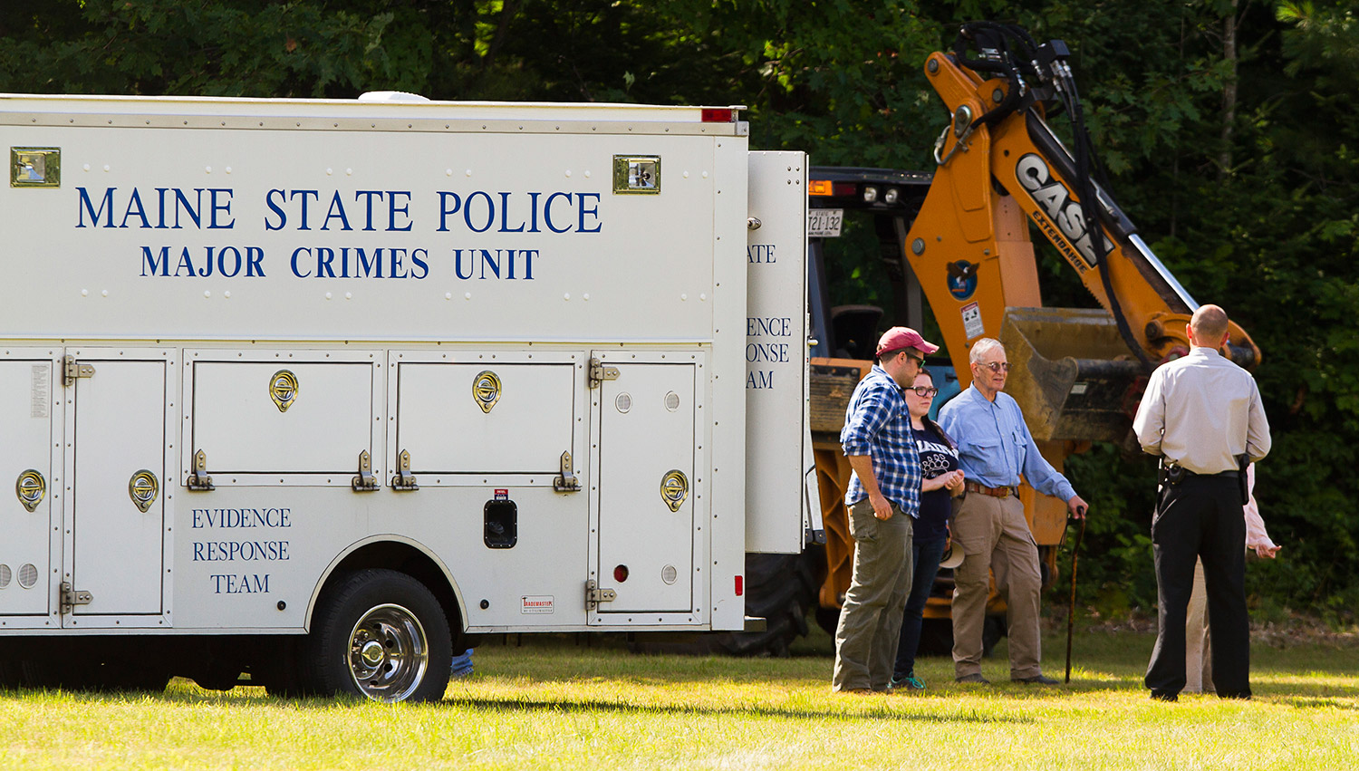 CANTON, ME - AUGUST 9:  Investigators conference near the state police major crime unit truck at thesearch scene for Kimberly Moreau near Rt 108 in Canton, Maine on Sunday, August 9, 2015. A back hoe was among the equipment used to dig for evidence in case. Kim has been missing since 1986. (Photo by Carl D. Walsh)