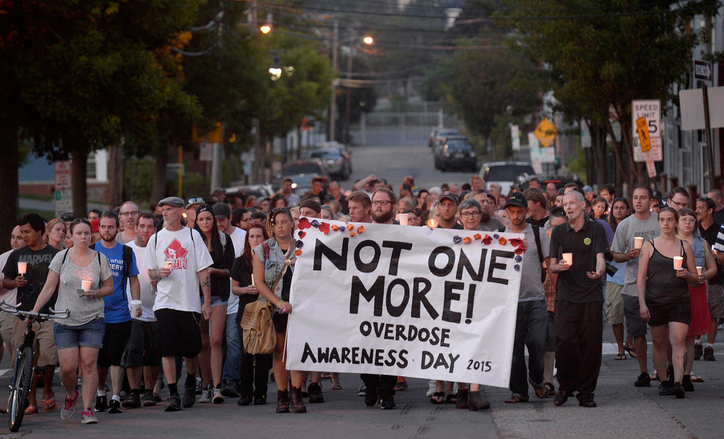 Participants march on Oxford Street in Portland on Monday evening during an event that was part of International Overdose Awareness Day.