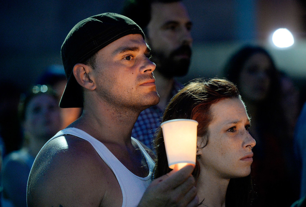 Scott McCullough and Hanna Marchetti of Portland stand together Monday evening during a candlelight vigil in Monument Square that was part of International Overdose Awareness Day.