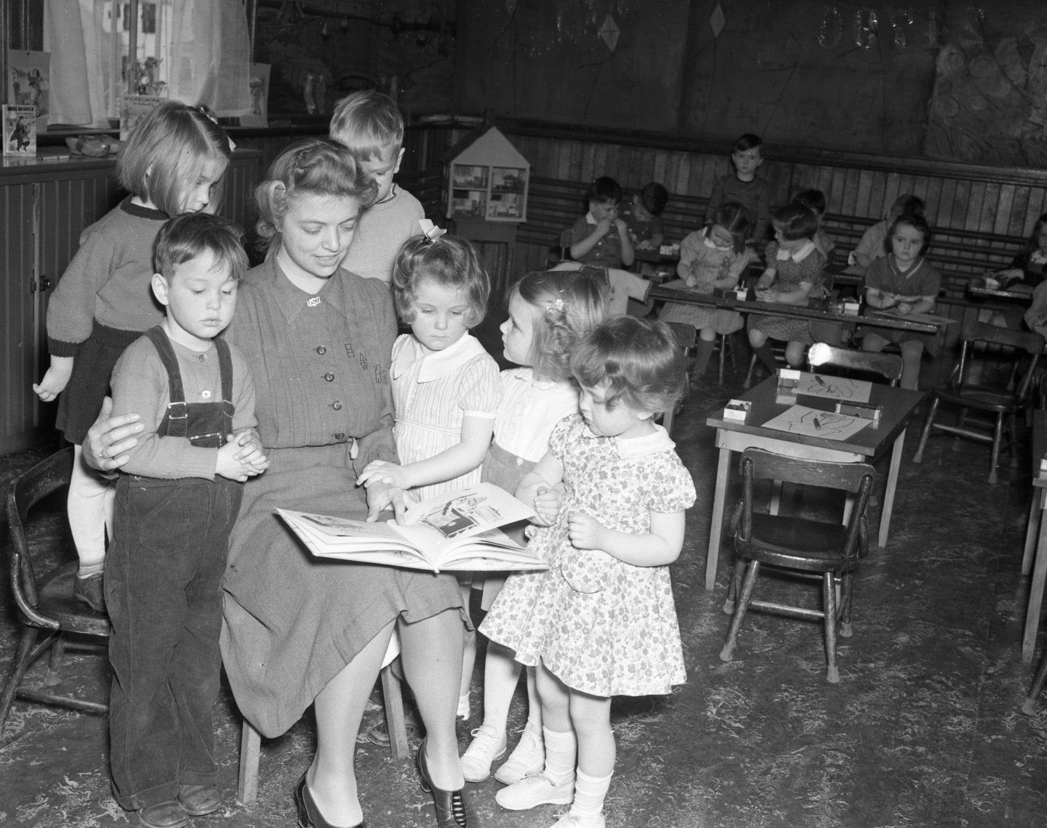 Teacher Ruth Davis reading to children in classroom, March 18, 1941. From the Portland Public Library archival collection of Portland Press Herald, Maine Sunday Telegram and Evening Express photos.