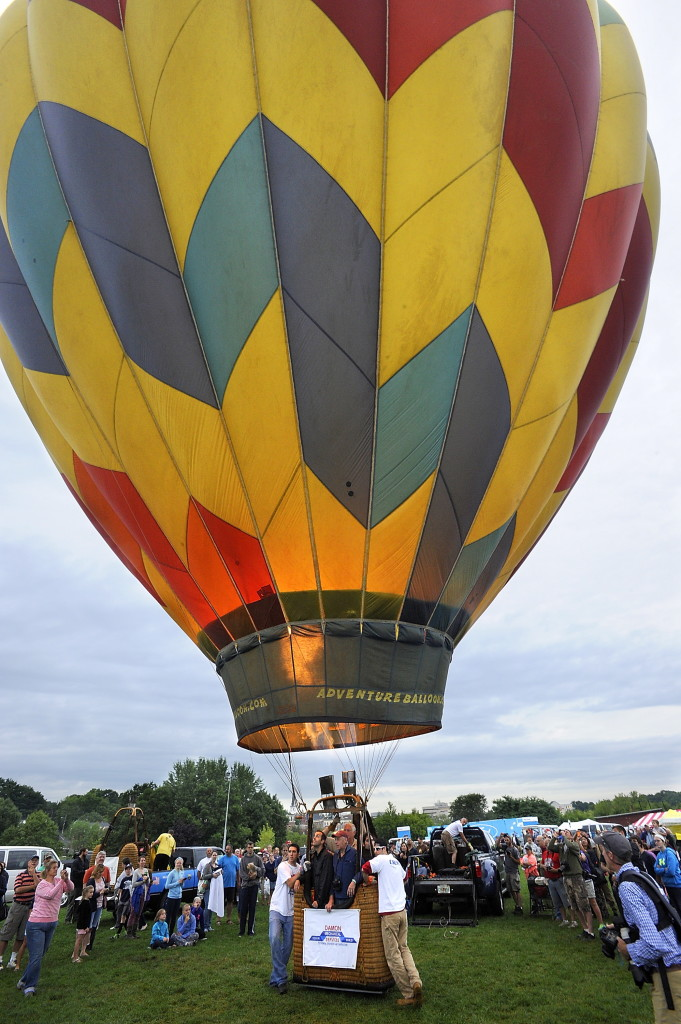 Frank Bart of Tampa, Florida, begins his liftoff of the first balloon to go up a little after sunrise at the 2015 Great Falls Balloon Festival  in Lewiston. Press Herald file photo