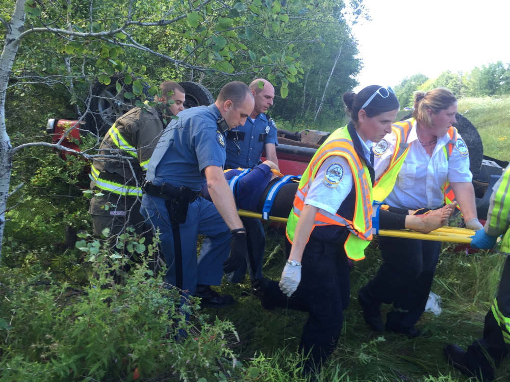 First responders remove one of the injured in an accident on Interstate 95 in Sidney Thursday morning.