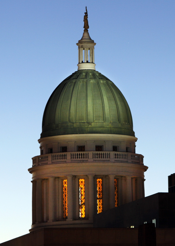 The old copper dome of the State House had a green hue after a century of exposure to the weather. Some of the old copper may be available to the public as soon as next month and plans are underway to construct a sculpture with the copper somewhere on the capitol grounds in Augusta. 2011 Associated Press File Photo/Robert F. Bukaty