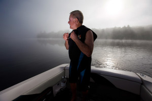 Water skier Pete Alderman, 79, dons his wetsuit for an early-morning ski on Crystal Lake in Harrison.
