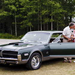 Winn and Judi Ritual of Woolwich kiss as they said goodbye to their 1968 Mercury Cougar CR-7 GT-E at the Owls Head Transportation Museum Tuesday, after it sold at auction. The car is one of only two like it in the country and came equipped from the factory with a 428 Cobra Jet Engine and a 4-speed manual transmission. It sold for the final price of $228,800. Gabe Souza/Staff Photographer