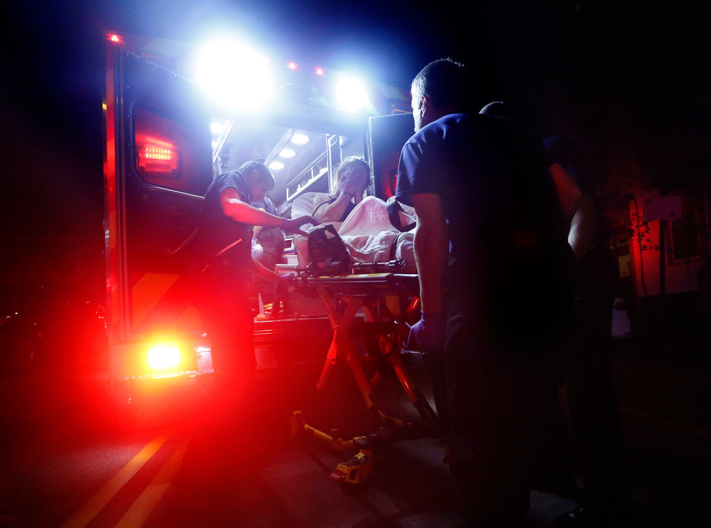 Portland paramedics load a woman into an ambulance after she overdosed on heroin in August. She survived, but 174 people in Maine died from overdoses in the first nine months of this year, according to new figures from the state Medical Examiner's Office.