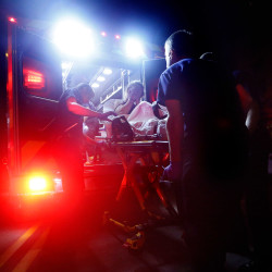 Portland paramedics load a 29-year-old woman into an ambulance after she overdosed on heroin and was found unconscious on Congress Street by a passerby. The Portland Fire Department – and emergency crews across Maine – respond to heroin overdoses  much more frequently than even three years ago, officials say.