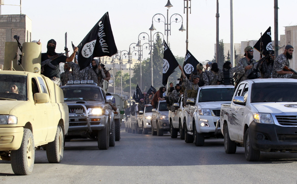 Militants parade their military vehicles along the streets of northern Syria's Raqqa province on June 30, 2014. A U.S.-led military campaign has squeezed the Islamic State's self-proclaimed capital in Raqqa, intelligence analysts say.