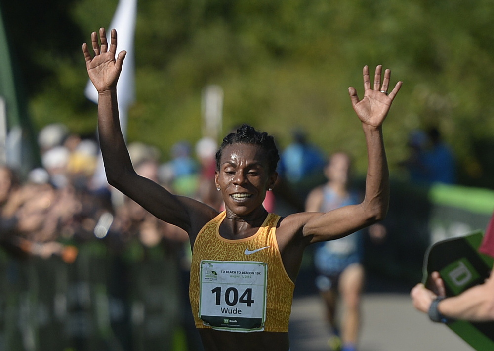 Wude Ayalew of Ethiopia is the fist female to cross the finish line of Saturday's Beach to Beacon 10K.