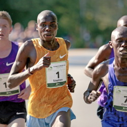 Eventual winner of the Beach to Beacon 10K, Stephen Kosgei Kibet of Kenya, center, tries to split his way between American Eric Jenkins of Portsmouth, N.H., and fellow Kenyan Daniel Salel, at right, during the latter stages of Saturday's race.