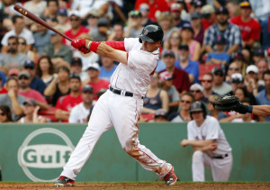 Boston Red Sox's Travis Shaw follows through on his second home run  against the Tampa Bay Rays during the eighth inning at Fenway Park in Boston Saturday.