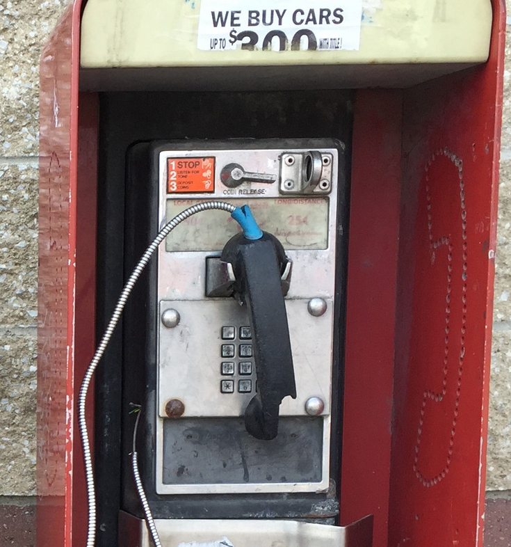 A pay phone remains at a gas station. The Associated Press
