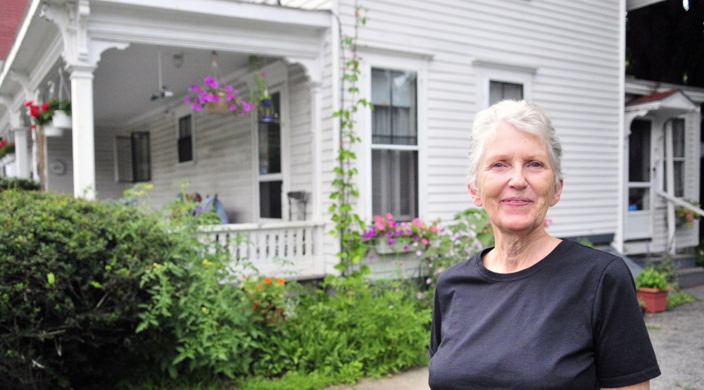 Shelia Stratton lives with her husband, Don Stratton, in an Augusta house that was built in 1850. The Strattons worry about restrictions that might come if a historic district is established.