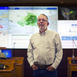 Martin Meltzer stands in the Emergency Operations Center at the Centers for Disease Control and Prevention in Atlanta. His worst-case model of the Ebola epidemic predicted far more cases than actually occurred but he is unbowed by critics who say he cried wolf.