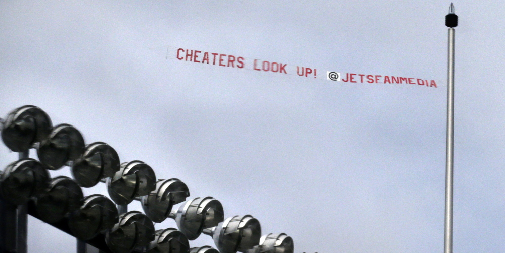 """Fans of the rival New York Jets had this """"cheaters"""" banner flown over Gillette Stadium last Thursday during the Patriots' first preseason practice. That gave Richard Pate of Biddeford the idea for flying his own banner over NFL chief Roger Goodell's home in Scarborough."""