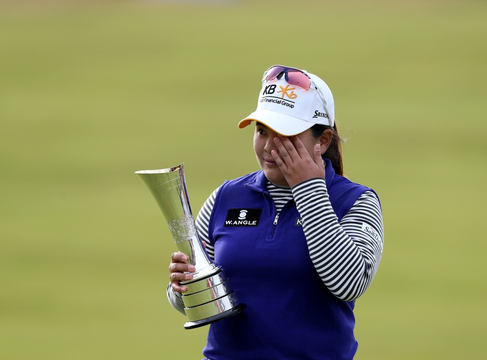 Inbee Park poses with the trophy after winning the Women's British Open golf championship at the Turnberry golf course in Turnberry, Scotland, on Sunday.