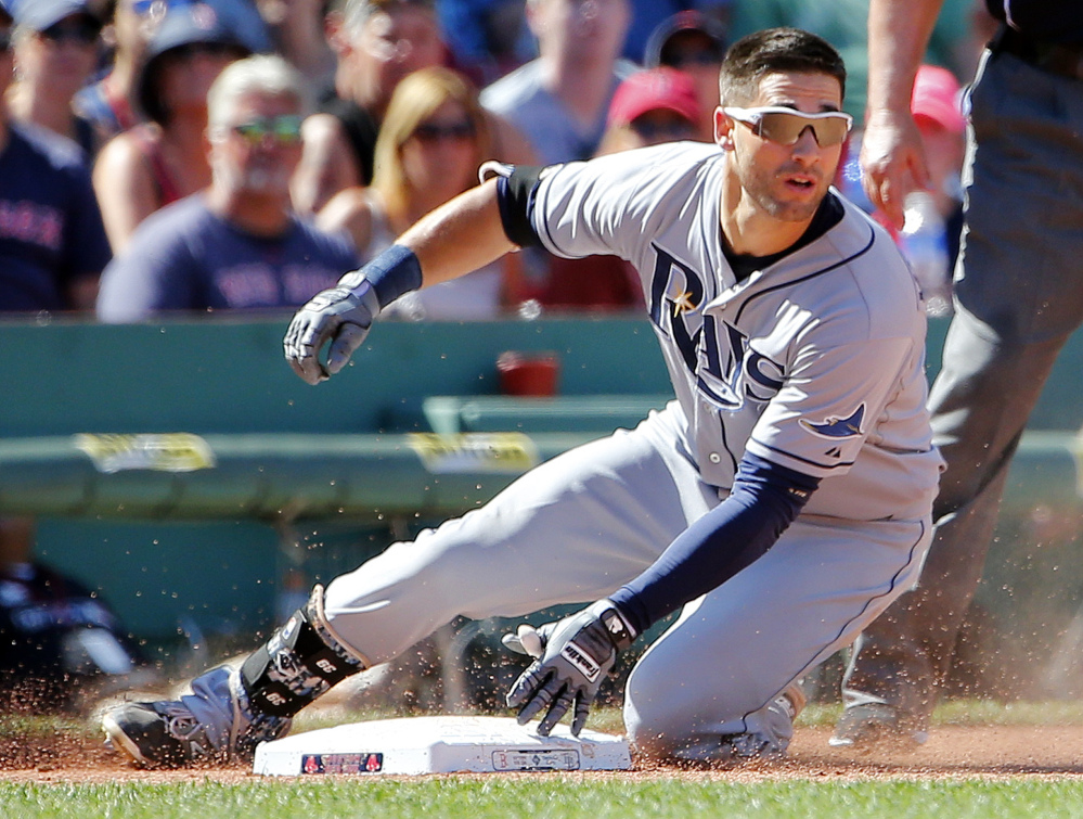 Rays center fielder Kevin Kiermaier slides into third base with a triple against the Boston Red Sox in the seventh inning at Fenway Park in Boston on Sunday.