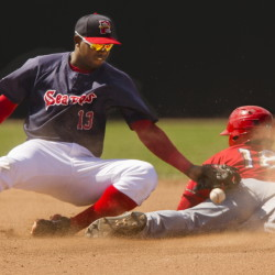 Sea Dogs shortstop Oscar Tejeda can't handle the throw cleanly as Wilmer Difo of the Harrisburg Senators slides safely into second for one of his four stolen bases Sunday at Hadlock Field. Difo went 5 for 7 with a walk, scored three runs and drove in two for Harrisburg, which won 16-12 in 11 innings.