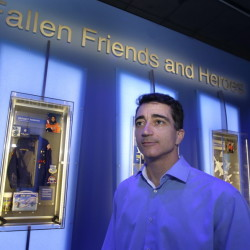 "Michael Ciannilli, who oversaw the ""Forever Remembered"" exhibit and memorial to the astronauts who died on the Columbia and Challenger space shuttles, stands in the display at the Kennedy Space Center Visitor Complex in Cape Canaveral, Fla."