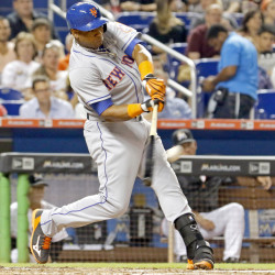 Yoenis Cespedes of the New York Mets hits a double to drive in two runs in the fifth inning during a 12-1 win by the Mets over the Marlins at Miami on Monday.