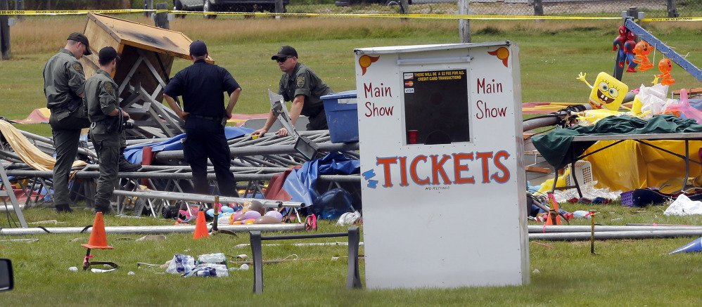 Investigators inspect the scene where a circus tent collapsed Monday in Lancaster, New Hampshire, killing two.