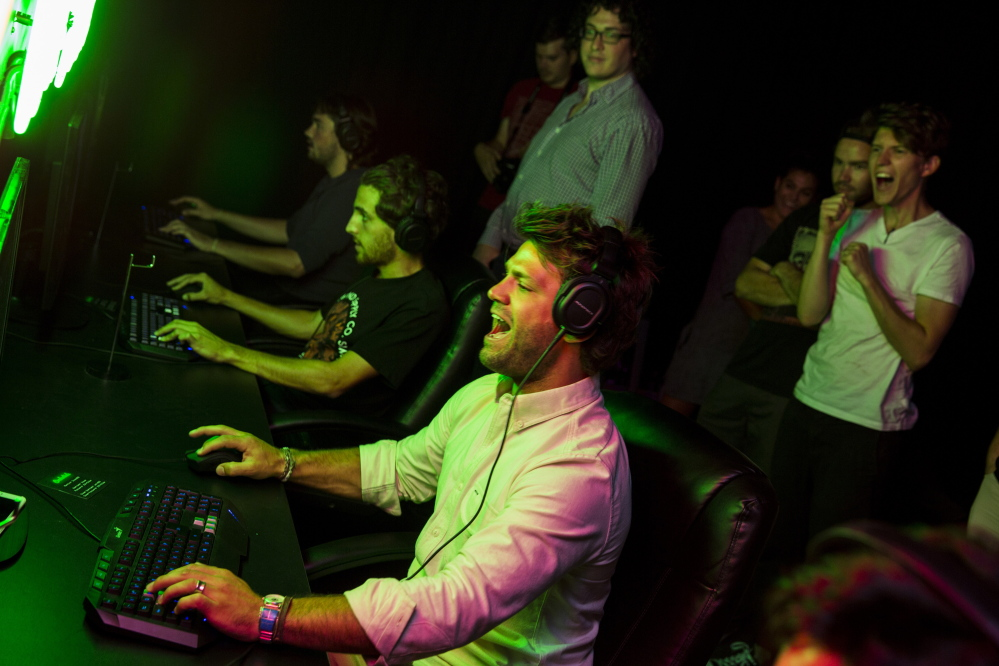 """Zefr co-founder and co-CEO Zach James, center, gets into the action during an internal tournament playing the video game """"Unreal Tournament"""" in Venice, Calif.  Jay L. Clendenin/Los Angeles Times"""