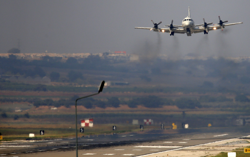 A U.S. Navy airplane takes off from the Incirlik Air Base on the outskirts of the city of Adana, southern Turkey, on Friday.