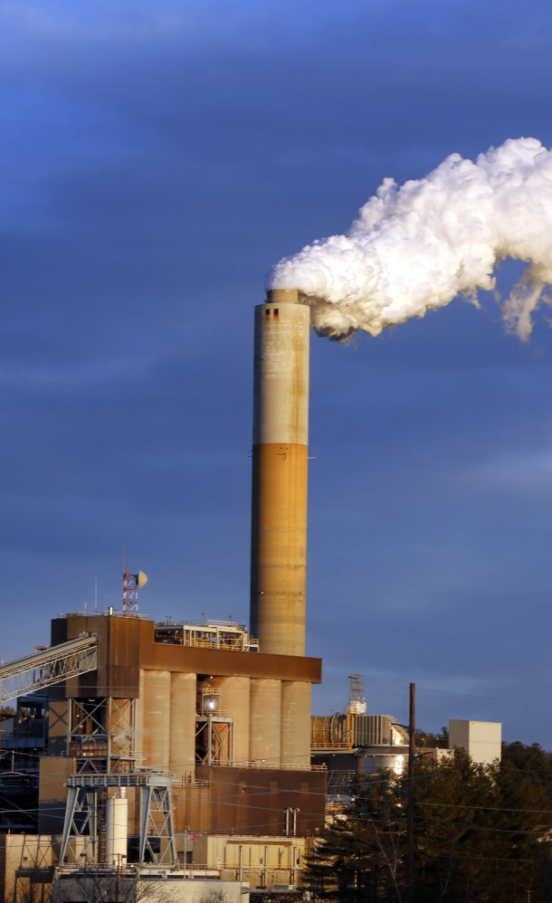 Merrimack Station in Bow, N.H. Electric power plants spewed the lowest amount of carbon dioxide for any month since 1988, the energy department says.