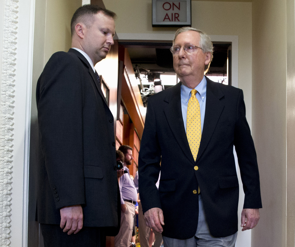 Senate Majority Leader Mitch McConnell leaves a news conference on Capitol Hill in Washington on Thursday. The Senate left Wednesday for an almost five-week vacation.