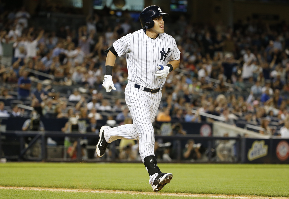 The Yankees' Jacoby Ellsbury watches his seventh-inning solo home run, which proved to be the game winner Thursday night against the Red Sox.