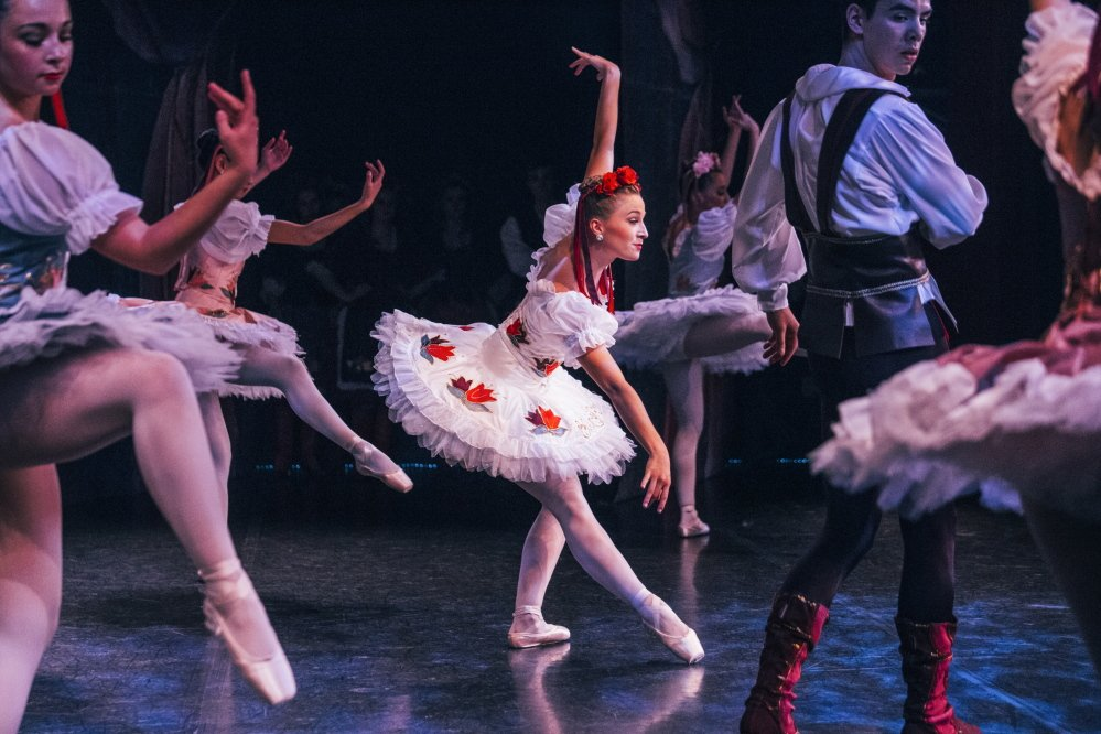 Maine State Ballet dancer Rhiannon Pelletier, who plays Swanhilda in the ballet Coppelia, dances with other company members during the dress rehearsal of Coppelia.