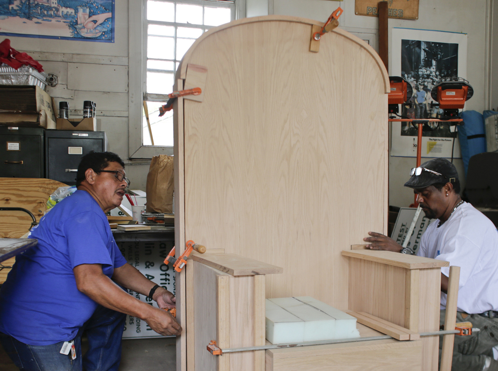 """Francisco Santamaria, left, working on a papal chair with Fausto Hernandez, says, """"It is a great pleasure to do this. The pope is our idol."""""""