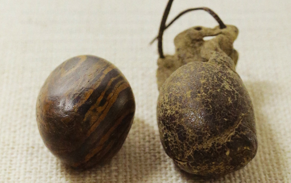The Mormon church recently released photographs of the smooth stone that founder Joseph Smith is believed to have used in creating the Book of Mormon – part of a church effort to reveal artifacts from its history. At right is a weathered leather storage pouch  that is believed to have been made by Emma Smith, one of Joseph Smith's wives.
