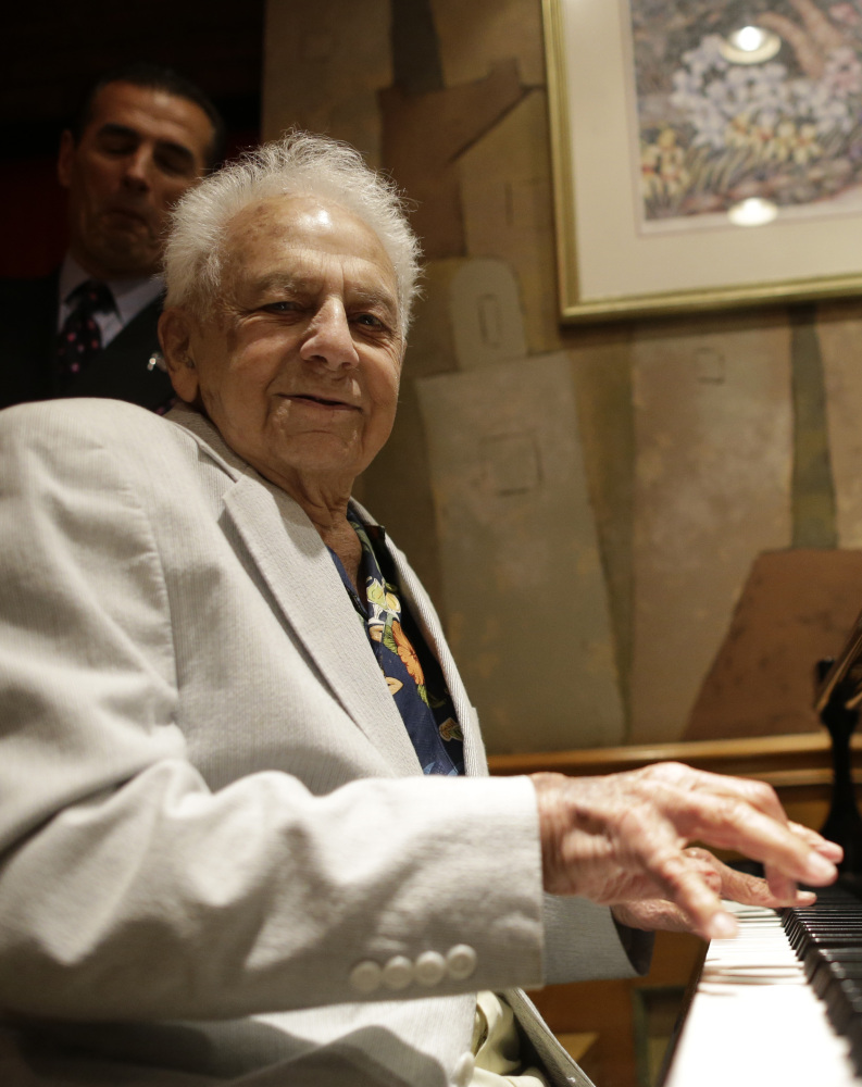 Irving Shields plays the piano Friday during a 100th birthday celebration for him at Nino's Tuscany restaurant in New York.