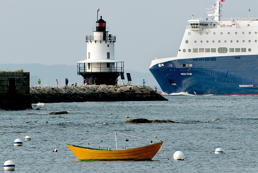 The Nova Star ferry dwarfs fishermen and tourists as it passes by Spring Point Ledge Light on its way to the Ocean Gateway terminal. The Portland-to-Yarmouth, Nova Scotia, service had lighter than expected passenger numbers for July, Nova Star Cruises reported last week, and authorities say it will not reach its goal of carrying 80,000 passengers this season. The ferry company also announced plans for an English Channel run over the winter, but the deal may have to be adjusted after an English port raised objections to being part of a new ferry route. Gabe Souza/Staff Photographer