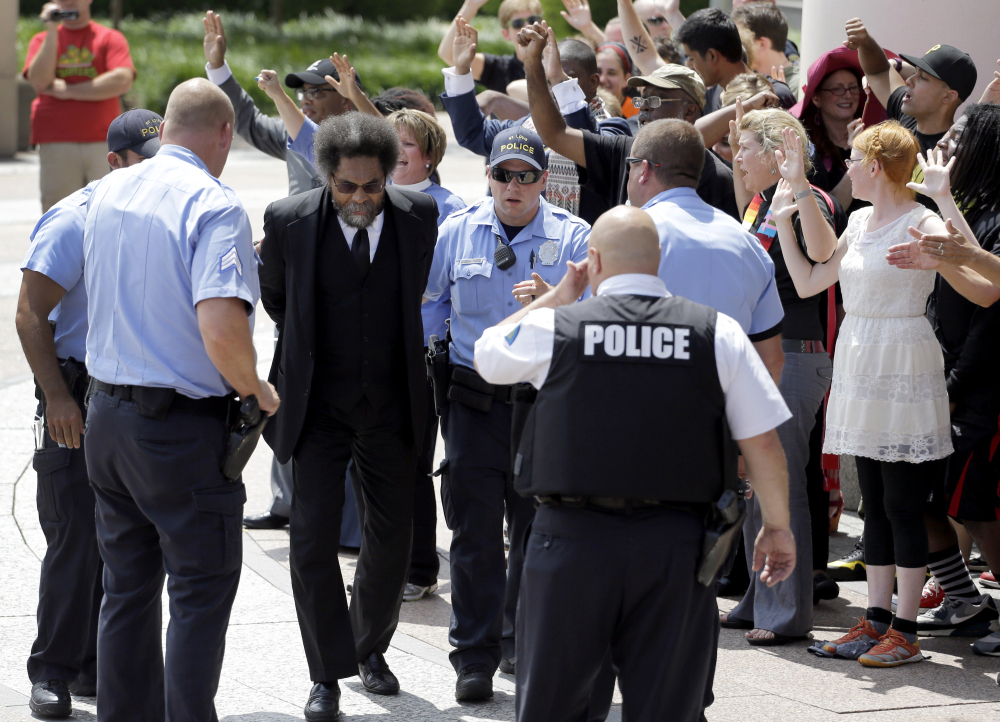 Civil rights activist Cornel West is arrested by St. Louis police during a protest outside the Thomas F. Eagleton Federal Courthouse in St. Louis on Monday. The arrests of West and a few dozen others were part of what was billed as a national day of civil disobedience.