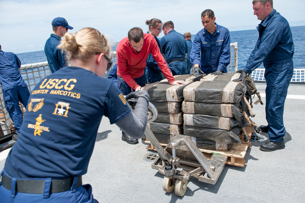 Crew members on the U.S. Coast Guard cutter Stratton secure cocaine bales taken from a semisubmersible in international waters off the coast of Central America in July.