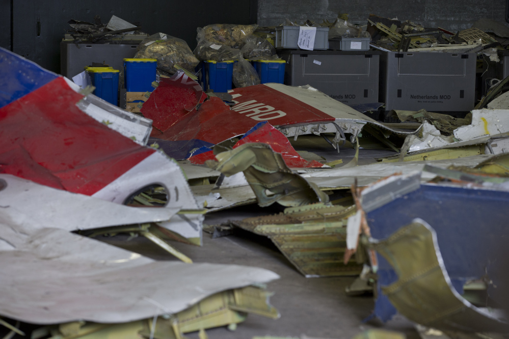 In this March 3, 2015 file photo parts of the wreckage of the Malaysia Airlines Flight 17 are displayed in a hangar at Gilze-Rijen airbase, Netherlands.