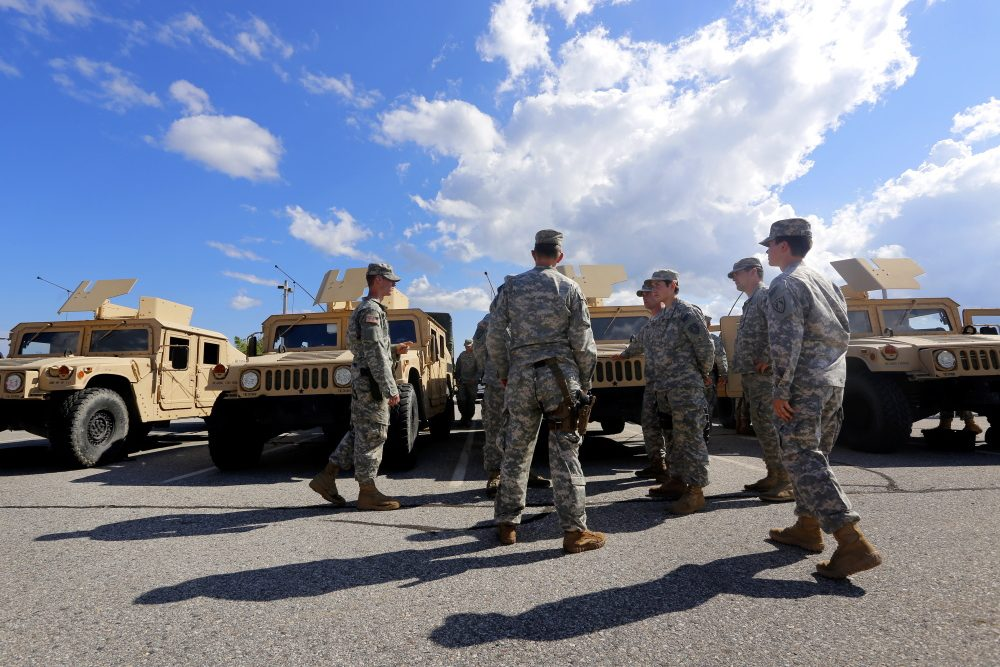 A group of soldiers convenes at the training location Wednesday. Derek Davis/Staff Photographer