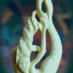"A mermaid carved from moose bone, above, and ""Within,"" below, carved to look like a wave. Val and Gerry Hoff make the jewelry in their Mount Vernon studio."