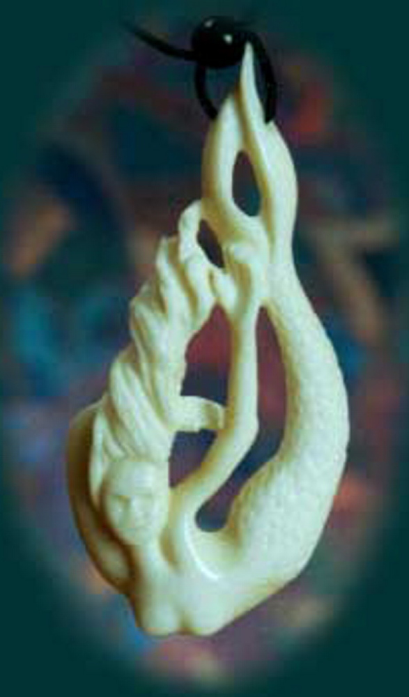 """A mermaid carved from moose bone, above, and """"Within,"""" below, carved to look like a wave. Val and Gerry Hoff make the jewelry in their Mount Vernon studio."""