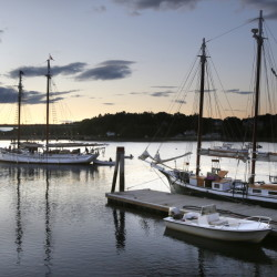 Belfast's Harbor Walk is popular for its scenes like this: the schooner Timberwind, left, pulling into dock after a sunset cruise and the schooner Mistress tied up at dock after a day of sailing on Aug. 6.